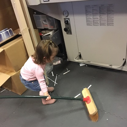 Grand daughter Amelia Rose, helping clean up around the shop. About US