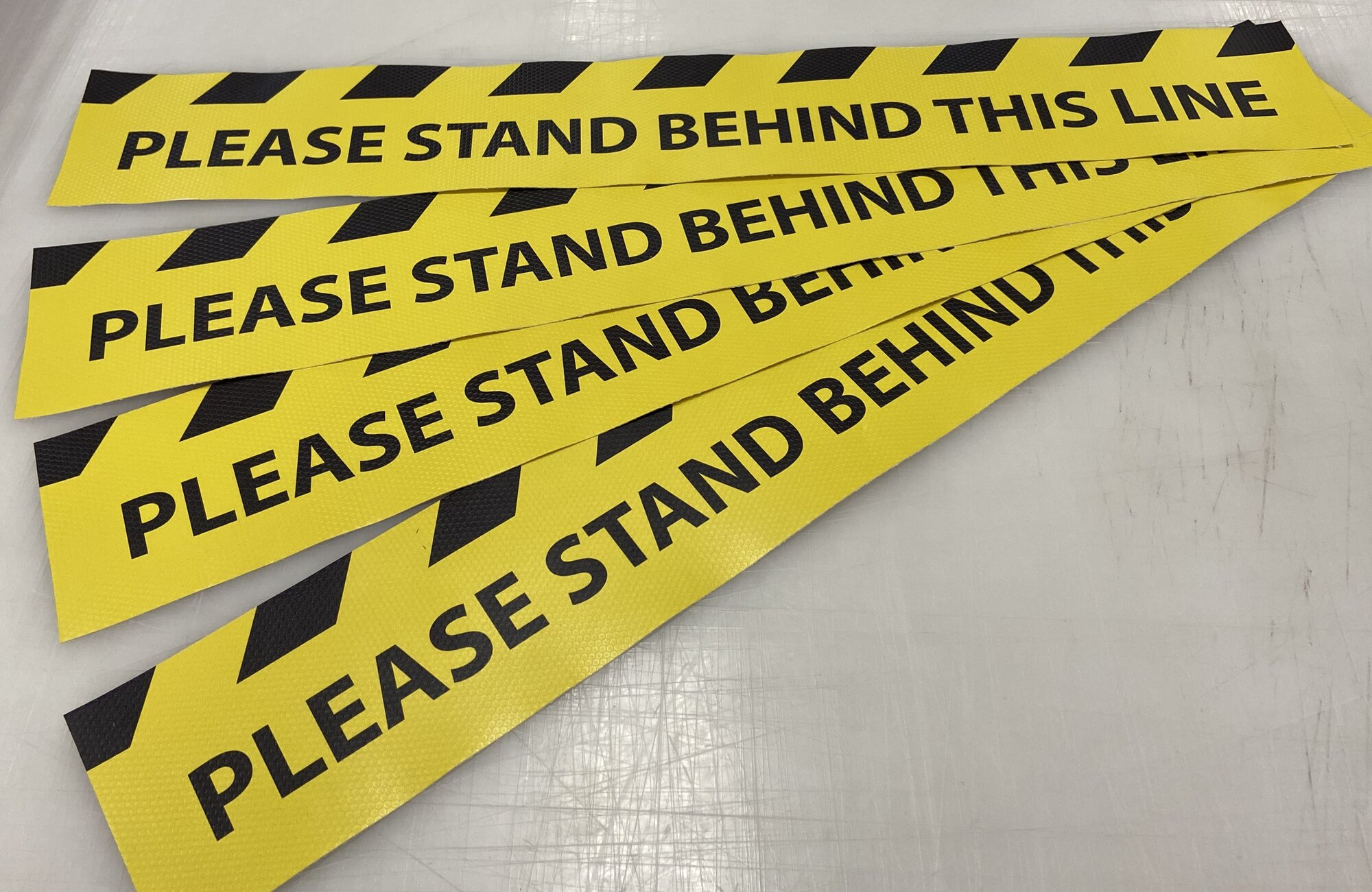 Please stand behind the line
